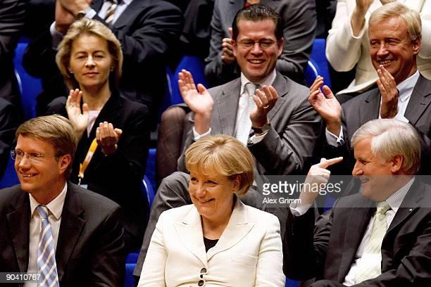 German Chancellor Angela Merkel of the Christian Democratic Union is surrounded by Ronald Pofalla Horst Seehofer Ursula von der Leyen KarlTheodor zu...