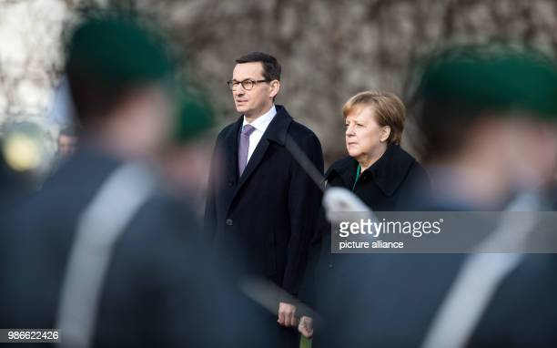 German Chancellor Angela Merkel of the Christian Democratic Union welcomes Polish Prime Minister Mateusz Morawiecki with military honours at the...