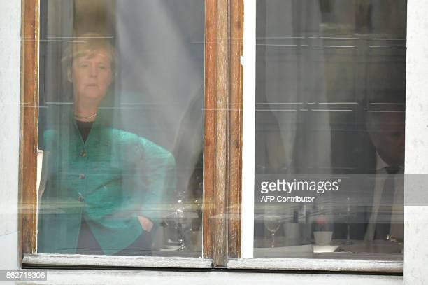 German Chancellor Angela Merkel of the Christian Democrats party looks out of the window next to Horst Seehofer leader of the conservative Christian...