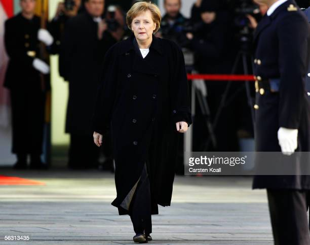 German Chancellor Angela Merkel of the Christian Democrats walks to welcome the Prime Minister of the Republic of Singapore Lee Hsien Loong at the...