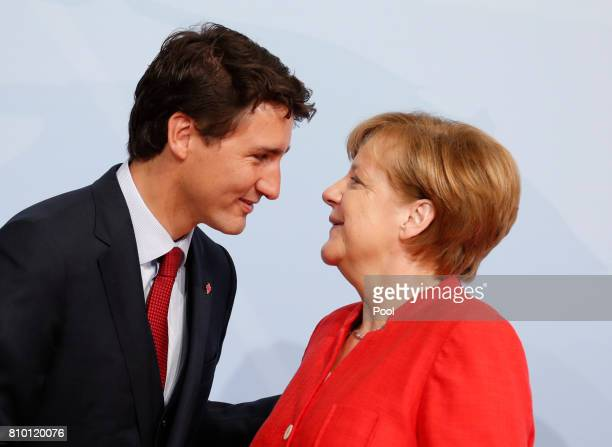 German Chancellor Angela Merkel officially welcomes Canadian Prime Minister Justin Trudeau to the opening day of the G20 summit on July 7 2017 in...