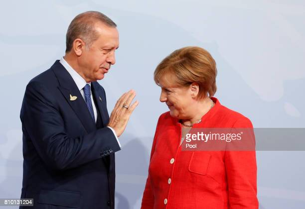 German Chancellor Angela Merkel officially welcomes Turkey's President Recep Erdogan to the opening day of the G20 summit on July 7 2017 in Hamburg...