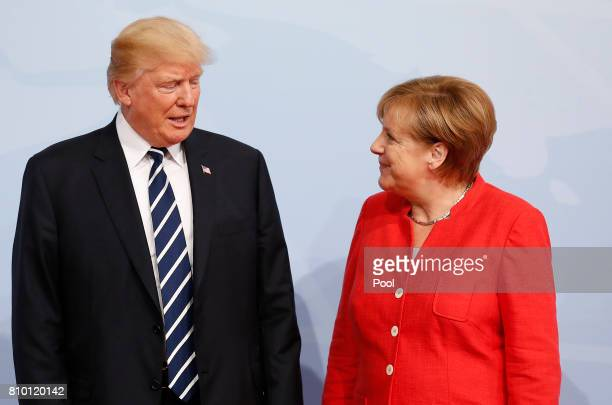 German Chancellor Angela Merkel officially welcomes US President Donald J Trump to the opening day of the G20 summit on July 7 2017 in Hamburg...