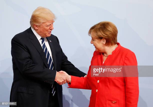 German Chancellor Angela Merkel officially welcomes US President Donald Trump to the opening day of the G20 summit on July 7 2017 in Hamburg Germany...