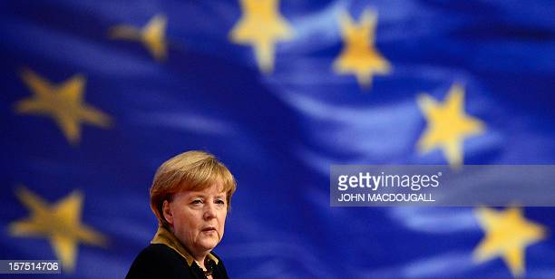 CROP German Chancellor Angela Merkel opens a congress of her ruling conservative Christian Democratic Union party on December 4 2012 in Hanover...
