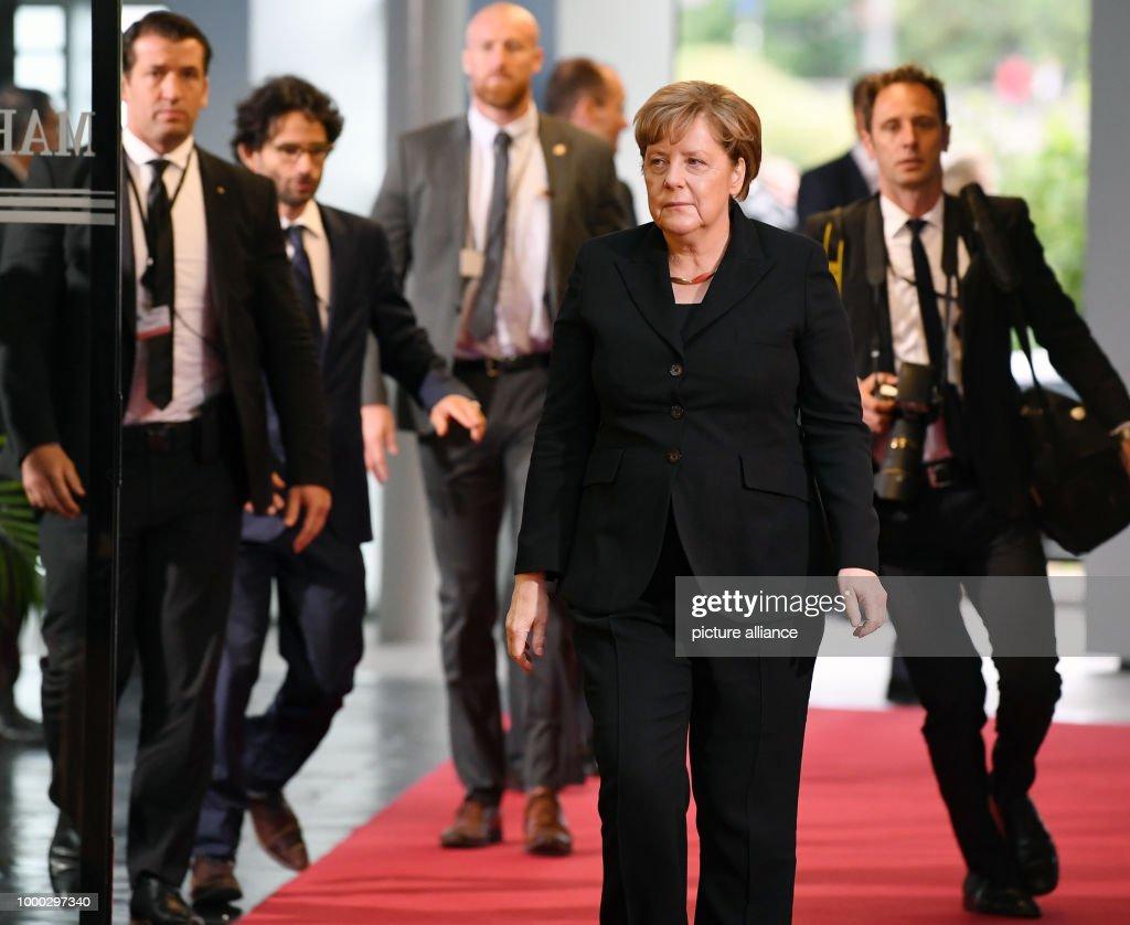 Watch German Chancellor Angela Merkel and former French president Nicholas Sarkozy video
