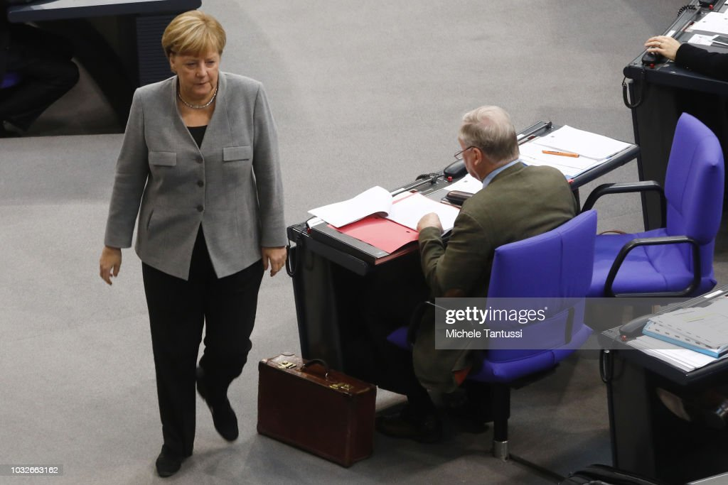 German Chancellor Angela Merkel (CDU) passes by the far right party, AfD, leader Alexander Gauland as she leaves a session of the German Parliament or Bundestag on September 13, 2018 in Berlin, Germany. Relations within the governing German coalition have once again become strained, this time due to comments made by German Interior Minister and Bavarian Christian Social Union leader Horst Seehofer following the recent murder of a German by refugees and the ensuing marches by right-wing supporters in the city of Chemnitz.