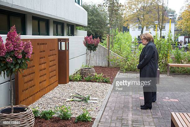 German Chancellor Angela Merkel pays her respects after laying down flowers at a memorial for the Germanwings plane crash victims including children...