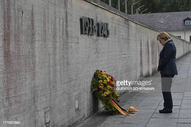 German Chancellor Angela Merkel pays respect during a wreathlaying ceremony at the wall of the Concentration Camp Memorial in Dachau southern Germany...