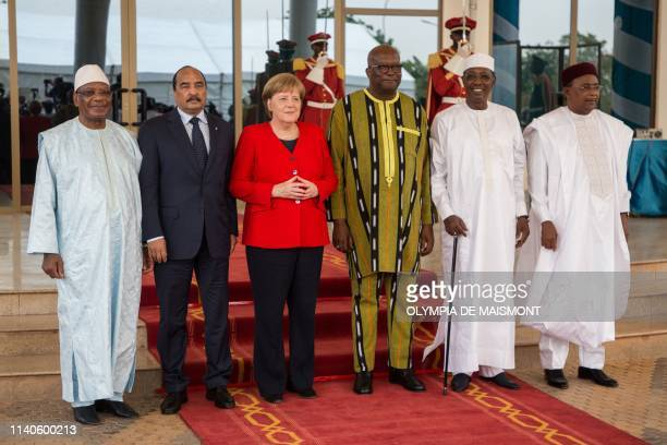 German Chancellor Angela Merkel poses for a group photo with Burkinabe President Marc Christian Kabore and the presidents of G5 Sahel Chadian...