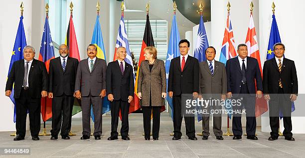 German Chancellor Angela Merkel poses for a group picture with the leaders of the Pacific island nations prior to a meeting on December 15 2009 at...