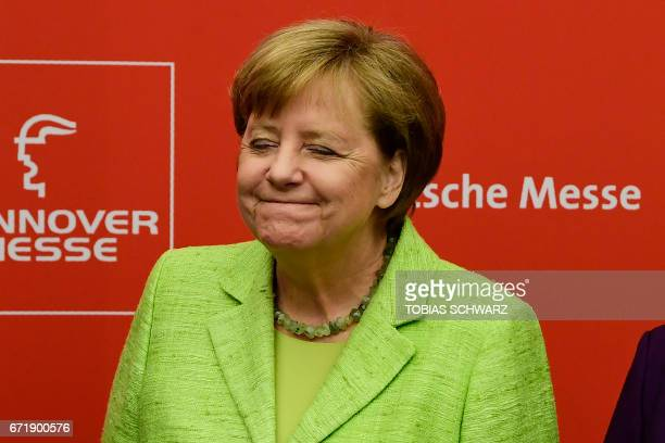 German Chancellor Angela Merkel poses for a photo ahead of the opening ceremony of the Hanover Messe industrial trade fair in Hanover central Germany...