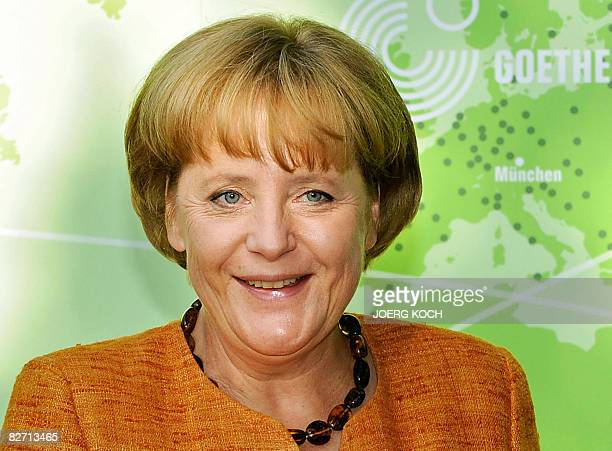 German Chancellor Angela Merkel poses for a photo during a visit to the GoetheInstitut in the southern German city of Munich on September 8 2008The...