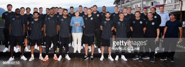 German Chancellor Angela Merkel poses for a photo with the German football team at Hotel Weinegg during her visit on June 3 2018 in Eppan Italy /...