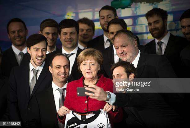 German Chancellor Angela Merkel poses for a selfie with the german national handball team at the Chancellery on March 09 2016 in Berlin Germany In...