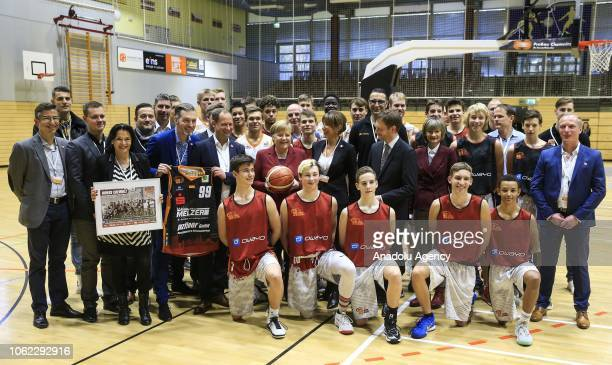 German Chancellor Angela Merkel poses for photograph with Chemnitz 99 basketball team's players during her visit the Chemnitz city in Germany on...
