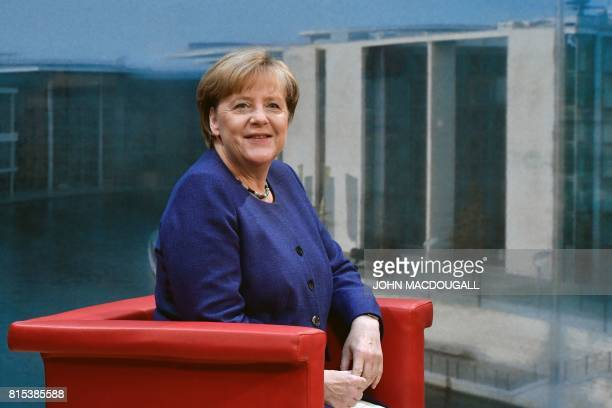 German Chancellor Angela Merkel poses for photographers before the recording of the traditional summer interview with public broadcaster TV station...