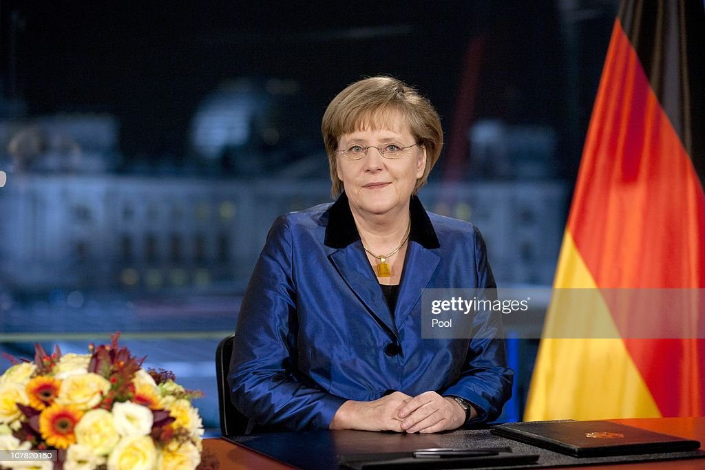 German Chancellor Angela Merkel poses moments after delivering her New Year's television address to the nation at the Chancellery (Bundeskanzleramt) on December 30, 2010 in Berlin, Germany.