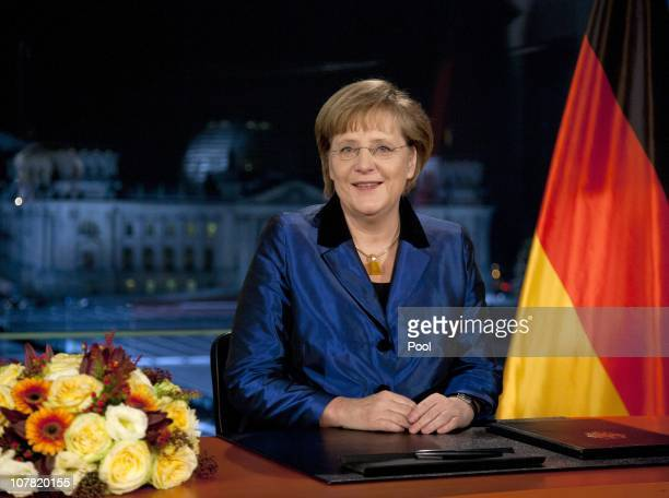 German Chancellor Angela Merkel poses moments after delivering her New Year's television address to the nation at the Chancellery on December 30 2010...