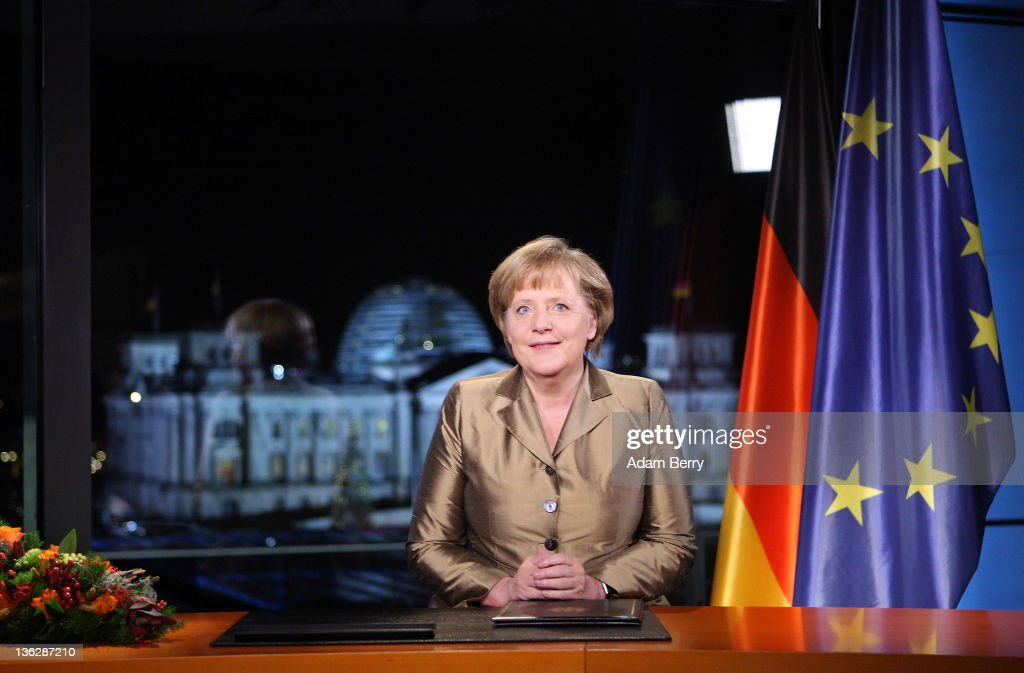German Chancellor Angela Merkel poses moments after giving her New Year's television address to the nation at the federal chancellery (Bundeskanzleramt) on December 30, 2011 in Berlin, Germany.