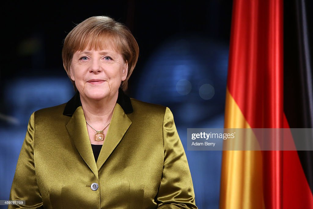 German Chancellor Angela Merkel poses moments after giving her New Year's television address to the nation at the federal chancellery (Bundeskanzleramt) on December 30, 2013 in Berlin, Germany. Merkel spoke of the challenges and priorities set for the German government for 2014.