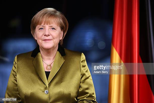 German Chancellor Angela Merkel poses moments after giving her New Year's television address to the nation at the federal chancellery on December 30,...