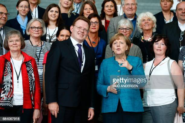 German Chancellor Angela Merkel poses with Altena's mayor Andreas Hollstein and other winners of the national integration award at the Chancellery in...