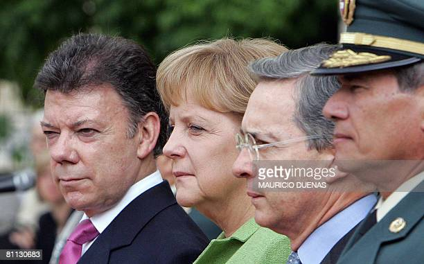 German Chancellor Angela Merkel poses with Colombian Defense Minister Juan Manuel Santos , Colombian President Alvaro Uribe and Colombian Army...