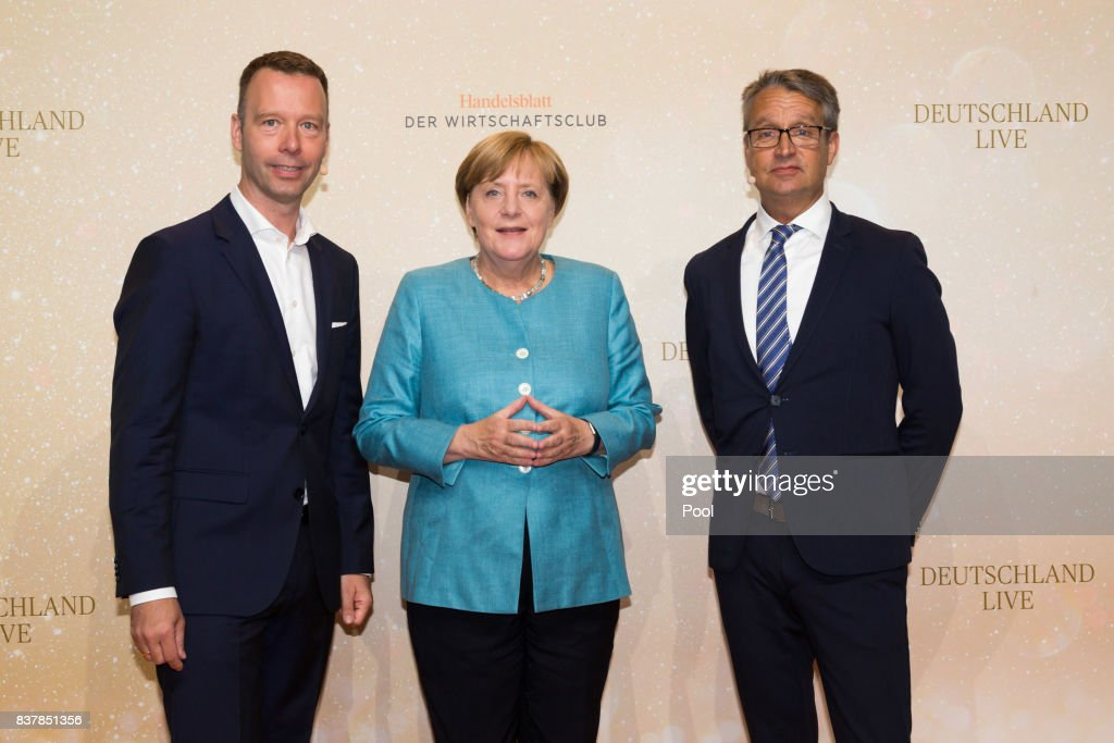 German Chancellor Angela Merkel (C) poses with Handelsblatt chief editor Sven Afhüppe (L) and Handelsblatt editor Gabor Steingart at 'Germany Live: Where does the West go?' at the Westhafen Event & Convention Center (WECC) on August 23, 2017 in Berlin, Germany. (Photo by Steffens - Pool/Getty Images)7