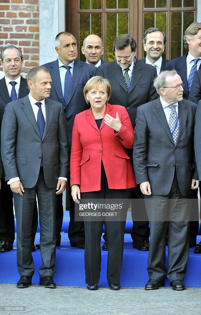 German Chancellor Angela Merkel (red) poses with other European People's Party (EPP) members before a party's statutory Summit, on June 16, 2010 in Meise, near Brussels, on the eve of an European Council gathering EU's heads of state. During the one-day meeting, EU leaders are expected to adopt 'Europe 2020', the new strategy for jobs and growth, and will also discuss the forthcoming G 20 summit, economic governance and post-Copenhagen climate strategy.