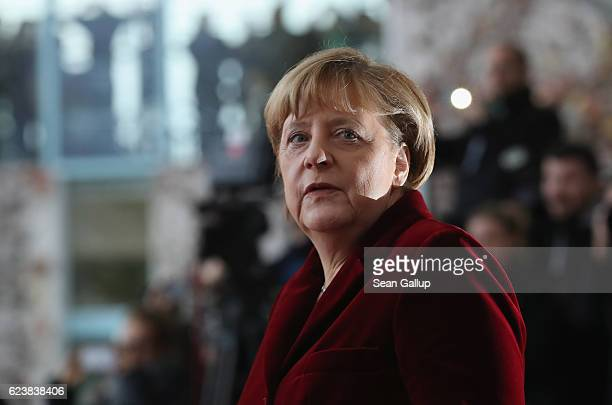 German Chancellor Angela Merkel prepares to greet US President Barack Obama upon his arrival at the Chancellery on November 17 2016 in Berlin Germany...