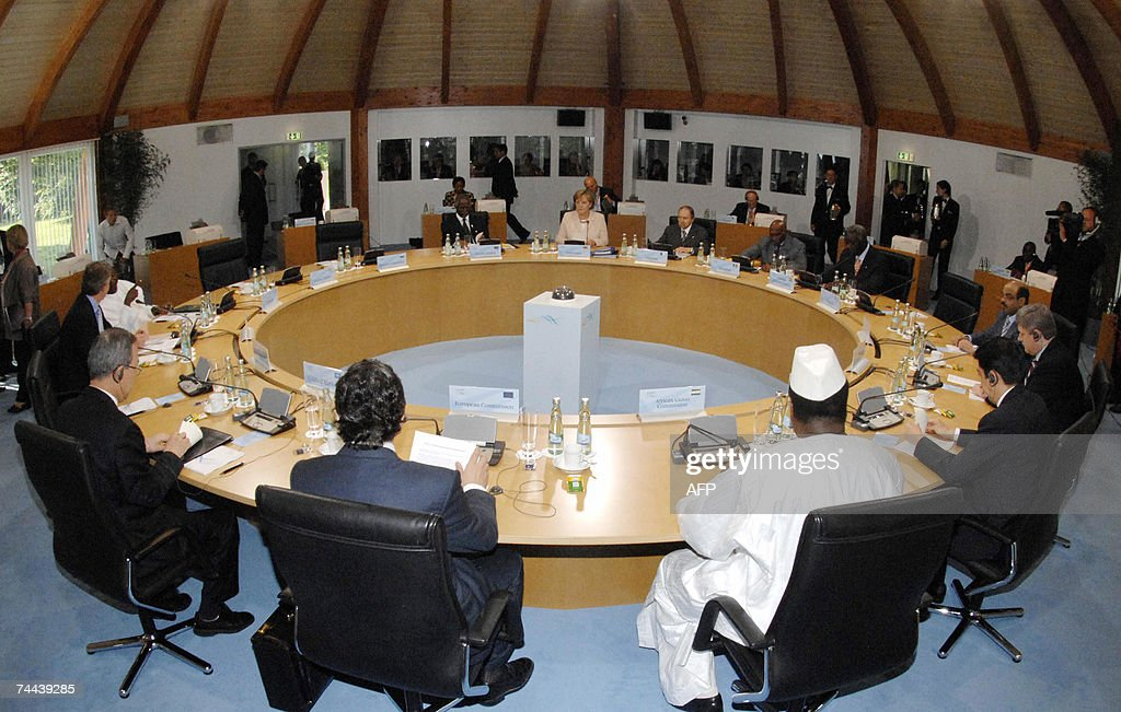 German Chancellor Angela Merkel (back C) presides over a working session of the leaders G8, the five top developing and African nations, 08 June 2007 on the last day of the G8 summit in Heiligendamm, northeastern Germany. The Group of Eight wealthiest nations agreed to pledge 60 billion dollars to fight AIDS and malaria in Africa. AFP PHOTO REGIERUNGonline/Bergmann