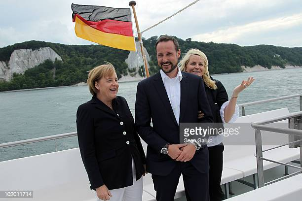 German Chancellor Angela Merkel , Princess Mette-Marit of Norway and Prince Haakon of Norway ride a boat along chalk cliffs in the Baltic Sea on June...