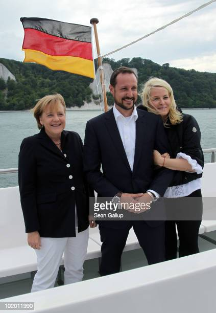 German Chancellor Angela Merkel Princess MetteMarit of Norway and Prince Haakon of Norway ride a boat along chalk cliffs in the Baltic Sea on June 12...