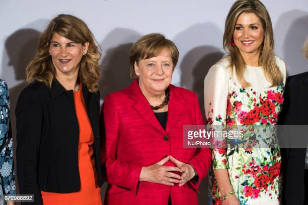 German Chancellor Angela Merkel Queen Maxima of the Nehterlands and President of the Association of German Women Stephanie Bschorr are pictured as...