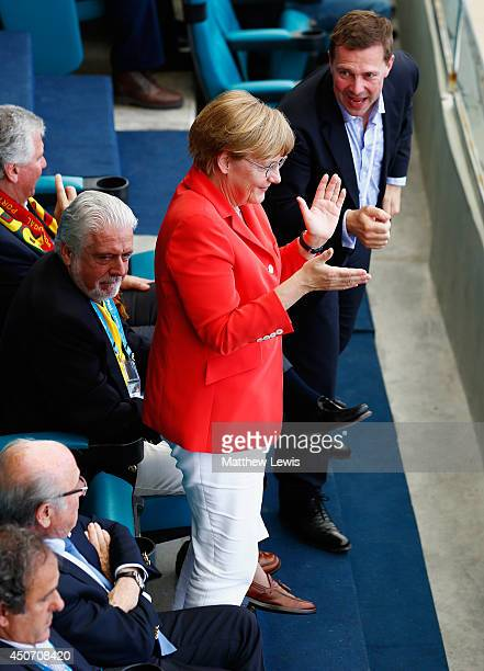 German Chancellor Angela Merkel reacts after a goal during the 2014 FIFA World Cup Brazil Group G match between Germany and Portugal at Arena Fonte...