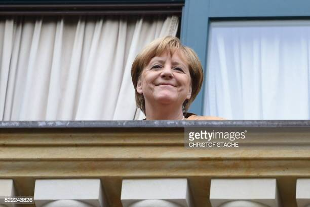 German chancellor Angela Merkel reacts as she arrives at the Festival Theatre on July 25 in Bayreuth southern Germany ahead of the opening of...