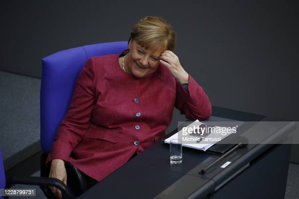 German Chancellor Angela Merkel reacts at the plenary room of the germans lower house of Parliament or Bundestag during the debate on budget law on...
