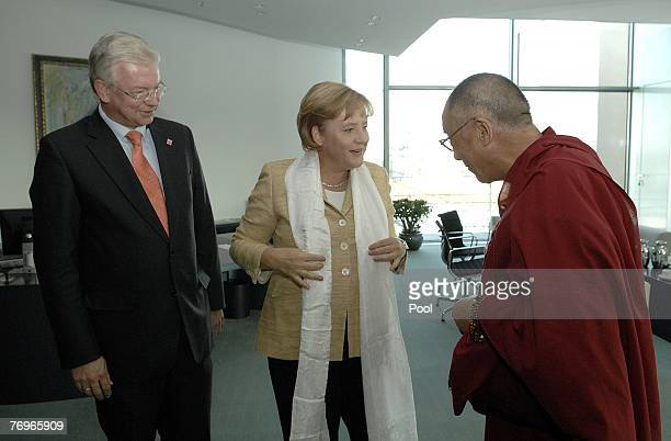 German Chancellor Angela Merkel receives a white scarf from the Dalai Lama at the Chancellery September 23 2007 in Berlin Germany China has heavily...