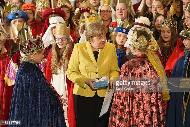 German Chancellor Angela Merkel receives child Epiphany carolers from across Germany at the Chancellery on January 7 2015 in Berlin Germany According...
