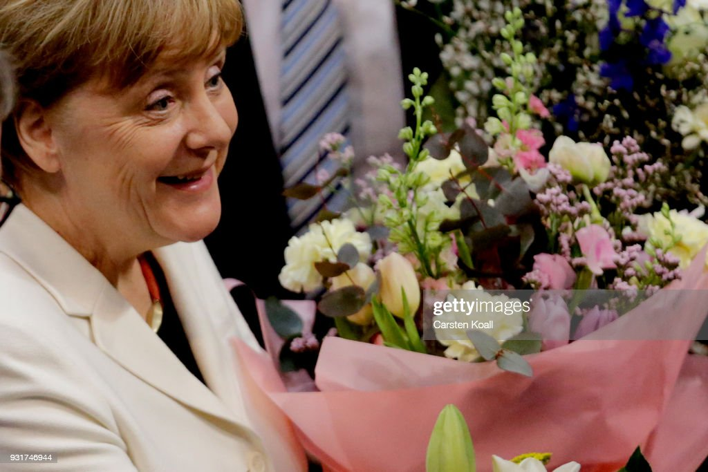 German Chancellor Angela Merkel (in white) receives congratulations from parliamentarians following her election by the Bundestag for a fourth term as chancellor on March 14, 2018 in Berlin, Germany. Members of the new German government, a coalition between Christian Democrats (CDU/CSU) and Social Democrats (SPD), will be sworn in today and will begin work immediately. The new government took the longest to create of any government in modern German history following elections last September that left the German Christian Democrats (CDU) as the strongest party but with too few votes in order to have a strong hand in determining the next coalition.