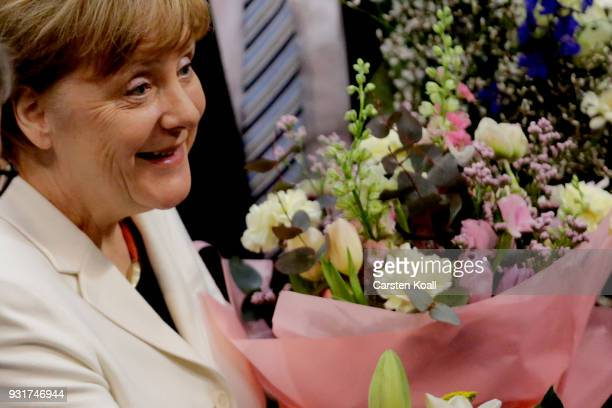 German Chancellor Angela Merkel receives congratulations from parliamentarians following her election by the Bundestag for a fourth term as...