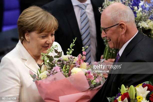 German Chancellor Angela Merkel receives congratulations from her colleague Christian Democrat Volker Kauder following her election by the Bundestag...