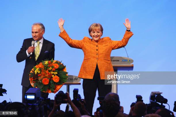 German Chancellor Angela Merkel receives flowers from Erwin Huber head of the CSU after her speech at the CSU party congress at NuernbergMesse on...