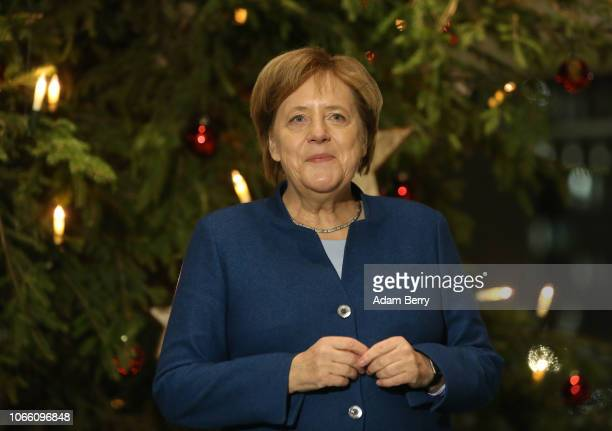 German Chancellor Angela Merkel receives one of the Chancellery's three official Christmas trees on November 28 2018 in Berlin Germany The three...