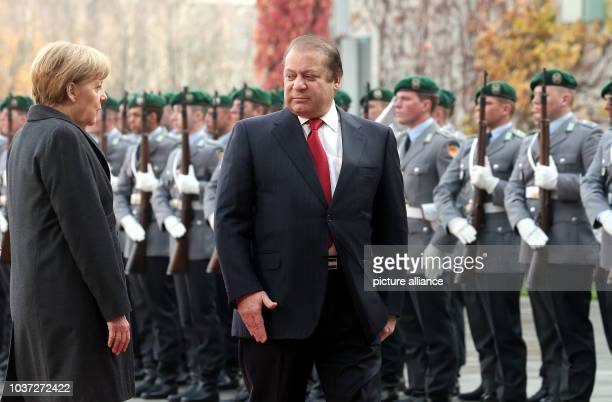 German Chancellor Angela Merkel receives Pakistani Prime Minister Muhammad Nawaz Sharif with military honors at the FederalChancellery in Berlin...