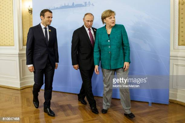 German Chancellor Angela Merkel receives Russian President Vladimir Putin and French President Emmanuel Macron in the Hotel Atlantic during the G20...