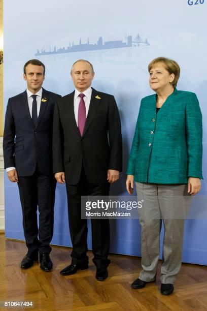 German Chancellor Angela Merkel receives Russian President Vladimir Putin and French President Emmanuel Macron in the Hotel Atlantic during the G20...