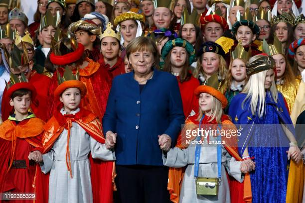 German Chancellor Angela Merkel receives the Epiphany Singers from different regions of the federal republic in the chancellery on January 7 2020 in...