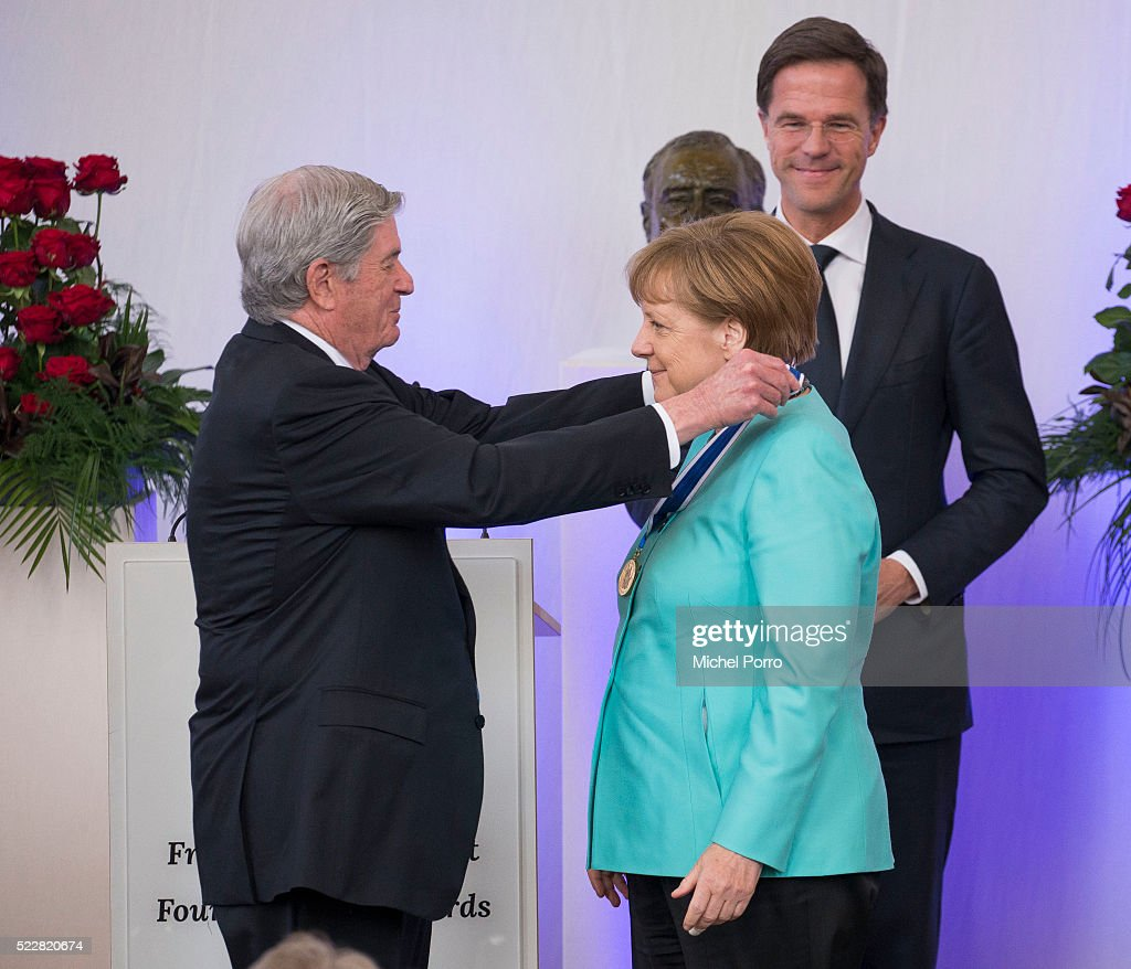 German Chancellor Angela Merkel receives the Four Freedoms Award from Elliott Roosevelt while Dutch Prime Minister Mark Rutte looks on during the Four Freedoms Awards ceremony on April 21, 2016 in Middelburg, Netherlands.